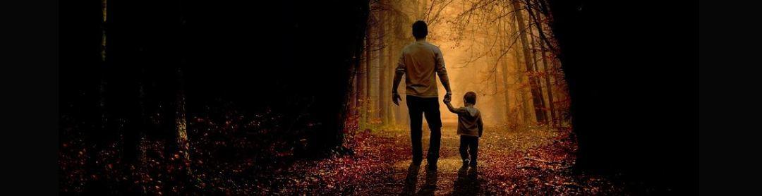 man and child walking