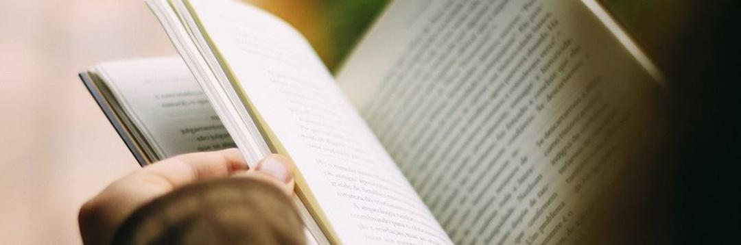 Person reading a book.