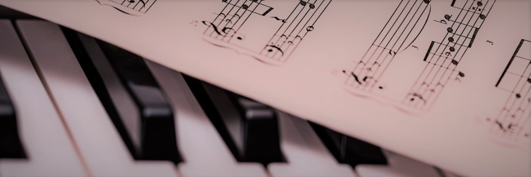 Picture of sheet music and piano. Image by stevepb on Pixabay