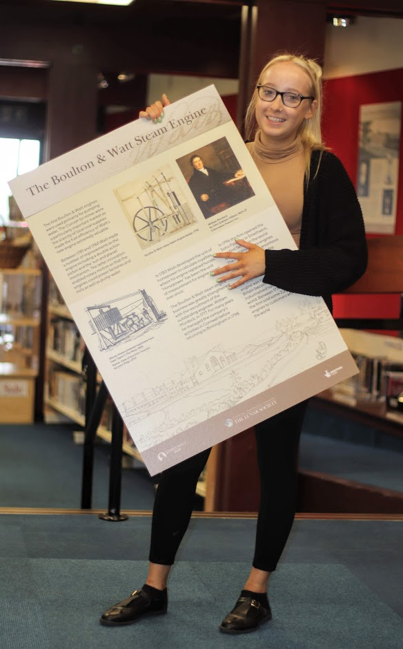 Library assistant Fern Christie helps set up one of the Watt displays at Bo'ness Library.
