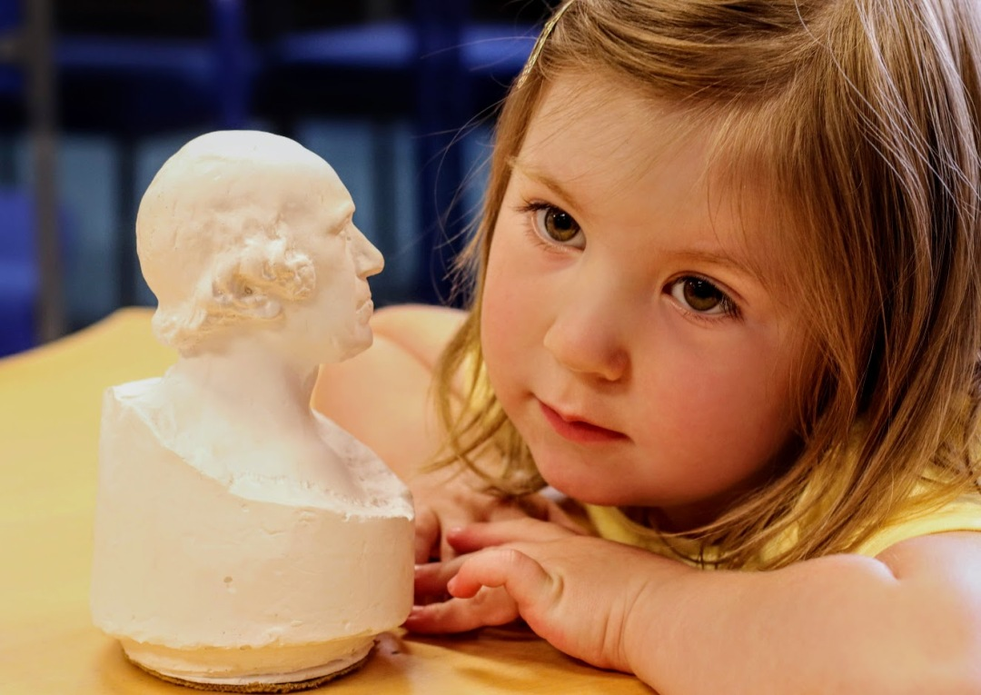 Little Bethany Stevens of Bo'ness checks out the little bust of James Watt on show at Bo'ness Library.