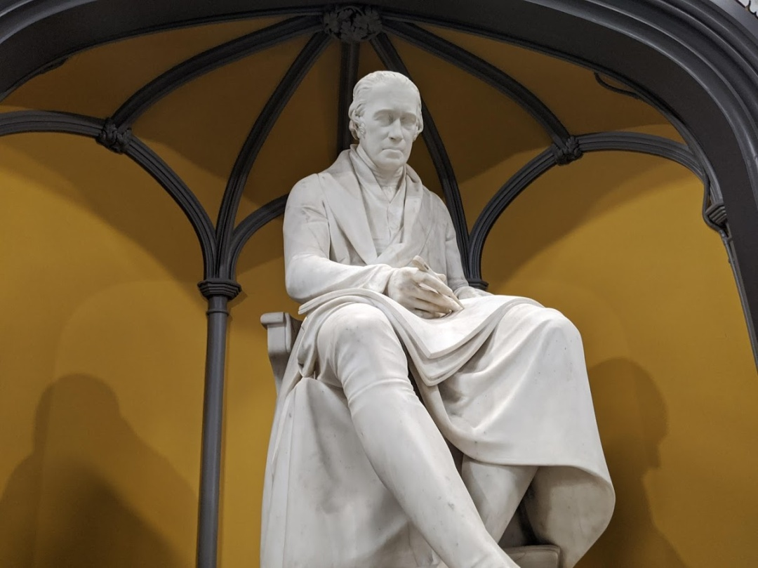 A massive sculpture of James Watt dominates the library building.